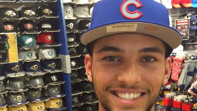 Tyson Miller smile in this file photo from last June as he was drafted in the fourth round by the Chicago Cubs.