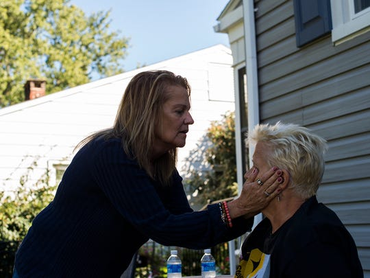 Lisa Kiick asks her sister-in-law, Ed Kiick's sister, Melissa Kiick, if her hands are cold as they sit outside on the patio on Sept. 20, 2015 in Gettysburg. Kiick was visiting for the weekend from her Mechanicsburg home. Ed Kiick said his sister is close to his wife and has been a huge support to both of them. Her nickname is 'The Opossum' because she is always popping in and out of their home on a vist, Ed said.