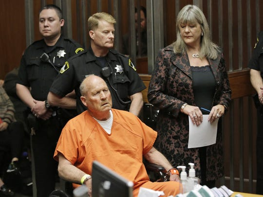 """In this Friday, April 27, 2018 file photo, Joseph James DeAngelo, 72, who authorities suspect is the """"Golden State Killer"""" responsible for at least a dozen murders and 50 rapes in the 1970s and 80s, is accompanied by Sacramento County Public Defender Diane Howard, right, during his arraignment in Sacramento County Superior Court in Sacramento, Calif. Authorities said they used a genetic genealogy website to connect some crime-scene DNA to DeAngelo."""