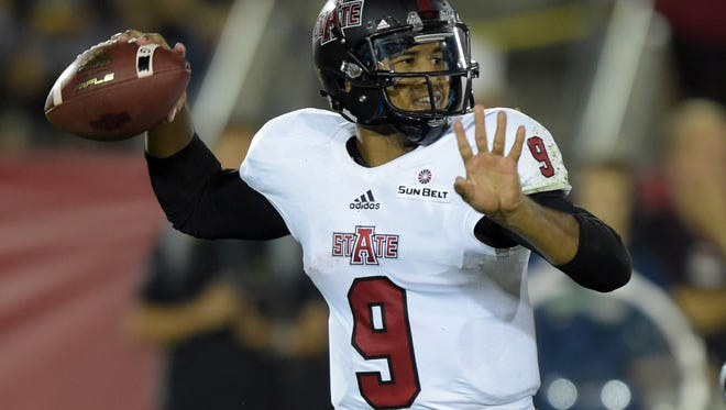 Arkansas State quarterback Fredi Knighten (9) throws a pass against the Southern California Trojans at Los Angeles Memorial Coliseum earlier this year.