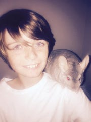 Mullica Hill's Chaz Blades, 11, is pictured with his pet chinchilla named Chim-Chi. The animal lover will donate more than $1,500 to a local rescue to pay for the medical treatment of three stray dogs left for dead in Georgia.