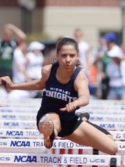 Nicolet's Destiny Huven clearing a hurdle en route to a state championship in the 100-meter hurdles at the 2017 state meet in La Crosse.