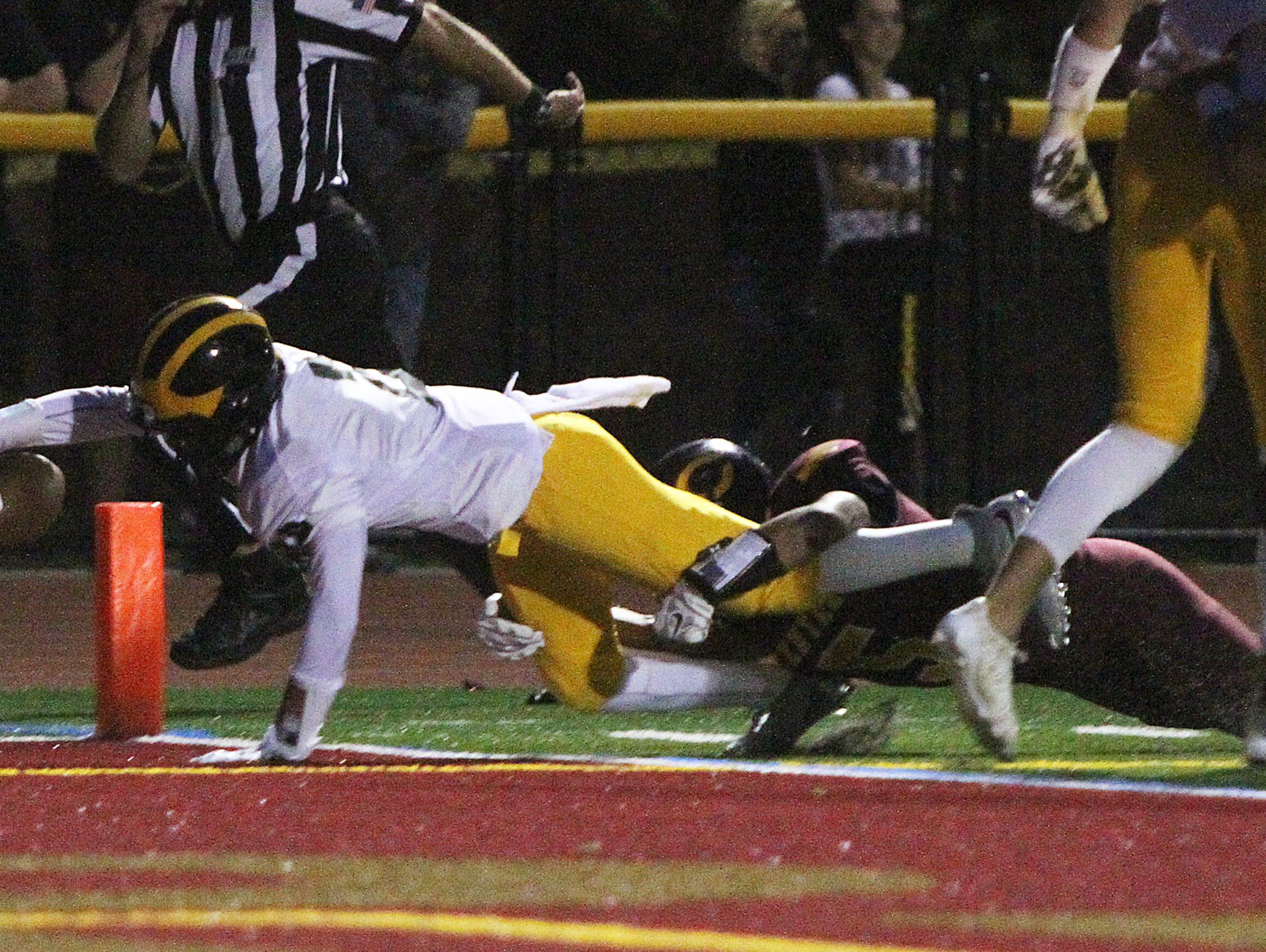 St. John Vianney at Central Regional High School football game held in Berkeley Twp. on Friday September 25 , 2015. Here St. John Vianney's # 2 Khalil Hakins dives in for a touchdown.