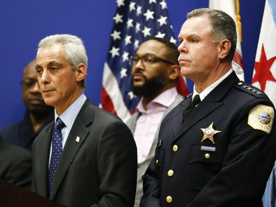 Chicago police superintendent Garry McCarthy, right,stands
