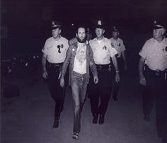 "George Carlin is arrested by Milwaukee police at Summerfest on July 21, 1972, on obscenity charges after performing his ""Seven Words You Can't Say on Television."" It was a landmark moment for comedy, Carlin's career and the Milwaukee festival."