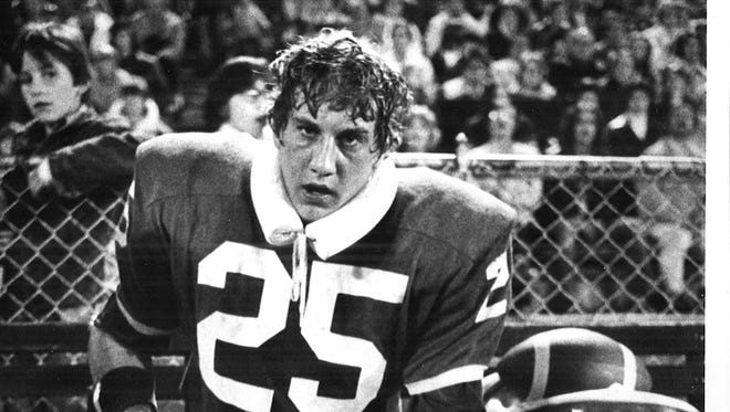 September 14, 1974: Assumption linebacker Dave Seran found the going tough against West Davenport's offensive line, and the look on his face reflects that as he takes a rest late in the first half. West Davenport went on to win 13-10, scoring a touchdown with five minutes left in the game.