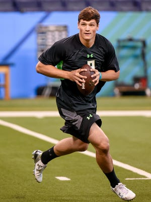Penn State quarterback Christian Hackenberg throws a pass as he runs a drill at the NFL football scouting combine, Saturday, Feb. 27, 2016, in Indianapolis. (AP Photo/L.G. Patterson)