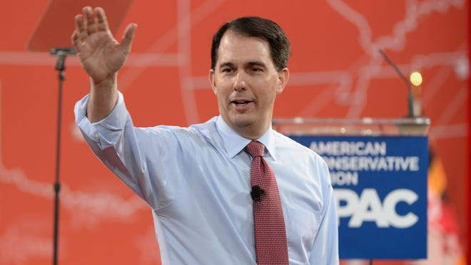 2/26/15 4:58:37 PM -- National Harbor, MD, U.S.A  -- Wisconsin Governor Scott Walker speaks at the 2015 Conservative Political Action Conference (CPAC) at the Gaylord National Resort and Convention Center.  Photo by H. Darr Beiser, USA TODAY Staff ORG XMIT:  HB 132665 CPAC 2/26/2015 [Via MerlinFTP Drop]