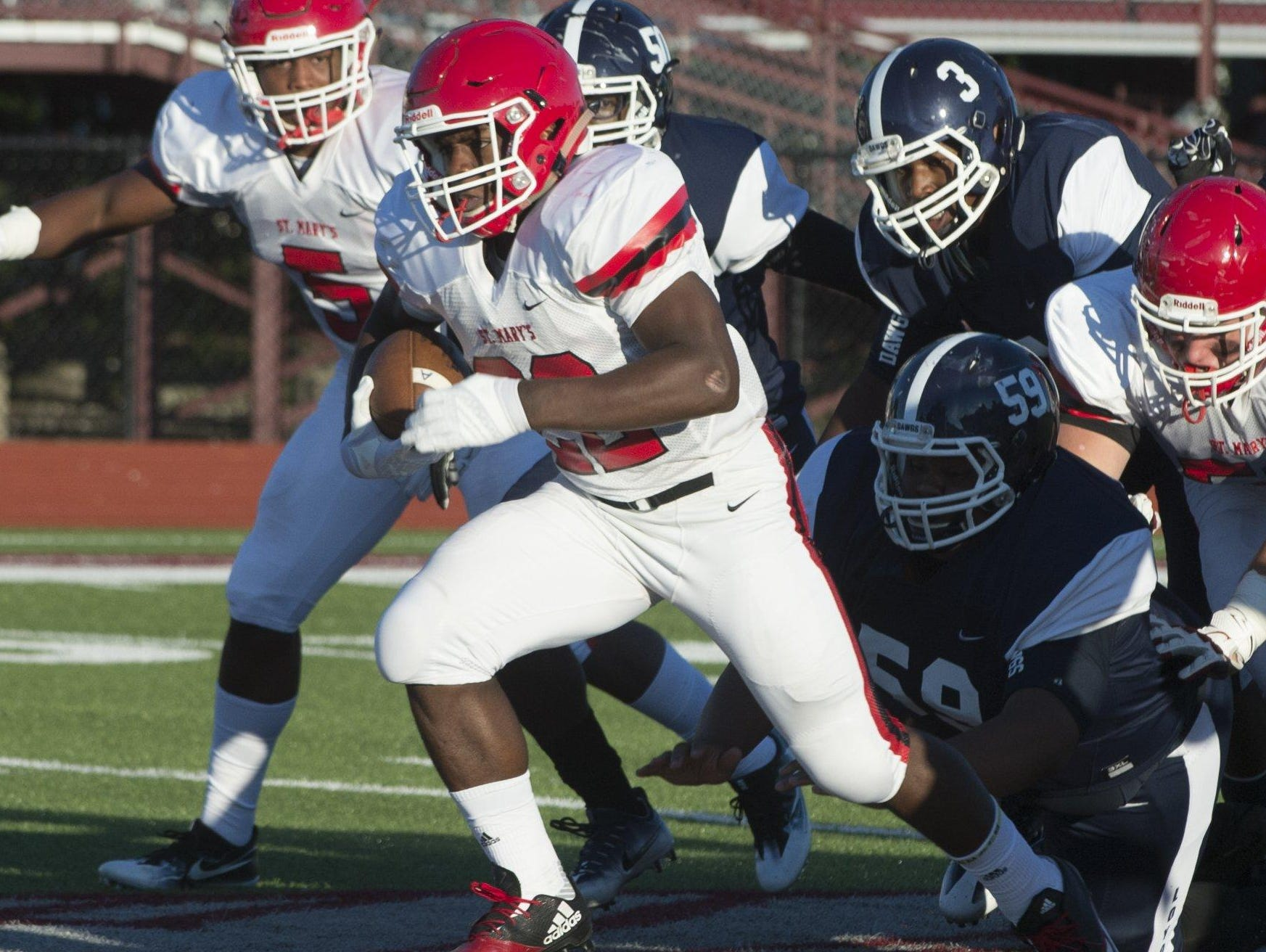 Orchard Lake St. Mary's junior running back RaShawn Allen breaks through the line for a 56-yard touchdown run against Detroit Loyola at Hazel Park on Sept. 2.