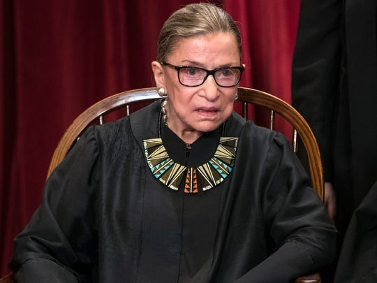 In this June 1, 2017, file photo, Associate Justice Ruth Bader Ginsburg joins other justices of the U.S. Supreme Court for an official group portrait at the Supreme Court Building in Washington.