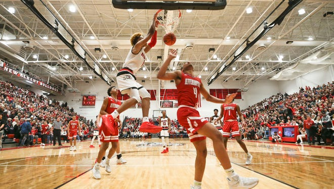 New Albany's Romeo Langford had 33 points including this home crowd-pleasing slam as the Bulldogs cruised past Jeffersonville 85-61Friday, Jan. 5.