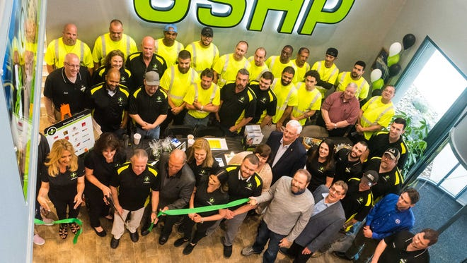 Employees at Garden State Highway Products cut the ribbon for their grand opening in Millville on Thursday, May 17.