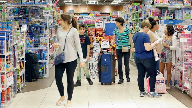 In this Nov. 25, 2016, file photo, shoppers shop in a ToysÒRÓUs store on Black Friday in Miami. ToysÒRÓUs, the pioneering big box toy retailer, announced late on Sept. 18, 2017 it has filed for Chapter 11 bankruptcy protection while continuing with normal business operations.