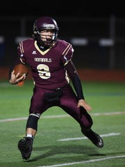 Austin Heck, pictured running with the football while playing for Arlington's team against Mount Vernon in Oct. 2016, was diagnosed with cancer recently.