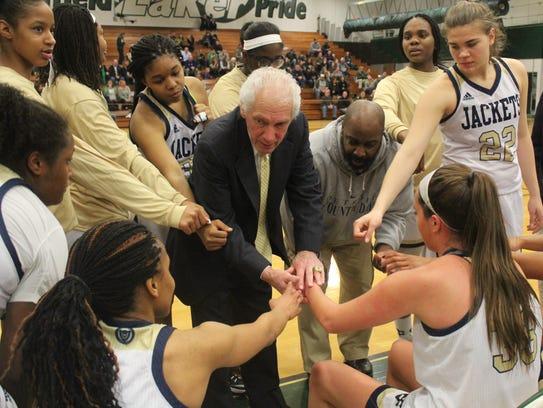 Veteran head coach Frank Orlando (center) heads to