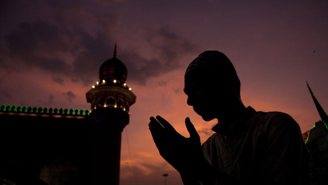 AP A Muslim man offer prayers before breaking his fast on the first day of the holy fasting month of Ramadan at Mecca Masjid in Hyderabad, India, on Sunday. An Indian Muslim offer prayers before breaking his fast on the first day of the holy fasting month of Ramadan at Mecca Masjid in Hyderabad, India, Sunday, May 28, 2017. Islam's holiest month is a period of intense prayer, dawn-to-dusk fasting and nightly feasts. Just before the fast, Muslims have a pre-dawn meal to get them through the day. Most Muslims break their fast like the Prophet Muhammad did some 1,400 years ago, with a sip of water and some dates at sunset. (AP Photo/Mahesh Kumar A.) ORG XMIT: MK101