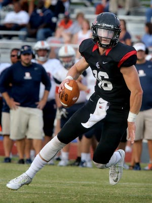 Stewarts Creek quarterback Chris Dye scrambles to pass the ball during the Jamboree game against Blackman on Friday, Aug. 14, 2015, at Stewarts Creek.