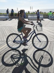 Cyclists ride the Rehoboth Boardwalk on a recent Saturday morning.