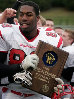 Homestead's Shelby Harris holds the Level 4 champion plaque after the WIAA Division 1 state semifinal game vs Middleton at Whitewater's Perkins Stadium on Nov. 15, 2008.