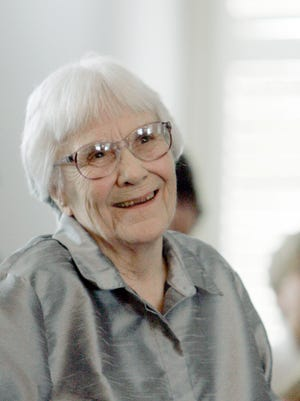 """In this Aug. 20, 2007, file photo, Harper Lee, author of the Pulitzer Prize-winning novel, """"To kill a Mockingbird,"""" smiles during a ceremony honoring the four new members of the Alabama Academy of Honor at the Capitol in Montgomery, Ala. Publisher Harper announced Tuesday, Feb. 3, 2015, that """"Go Set a Watchman,"""" a novel Lee completed in the 1950s and put aside, will be released July 14. It will be her second published book."""