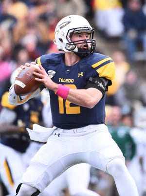 Toledo Rockets quarterback Phillip Ely (12) drops back to pass during the first quarter against the Eastern Michigan Eagles at Glass Bowl.