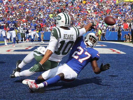 Bills rookie cornerback Tre'Davious White (27) breaks up this pass in the end zone intended for Jets receiver Jermaine Kearse (10).