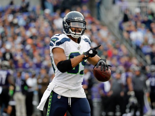 Seattle Seahawks wide receiver Doug Baldwin gestures after scoring a touchdown during an NFL football game against the Baltimore Ravens, Sunday, Dec. 13, 2015, in Baltimore.