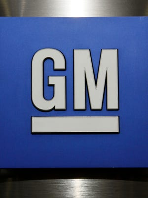 This Jan. 25, 2010, file photo, shows a General Motors Co. logo during a news conference in Detroit. General Motors Co.