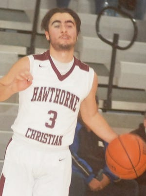 Hawthorne Christian senior guard Mike Aust was the leading scorer on the team with 10 points per game.