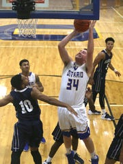 Ontario's Owen Zeiter jumps for the basket during a home game against Sandusky on Thursday evening.
