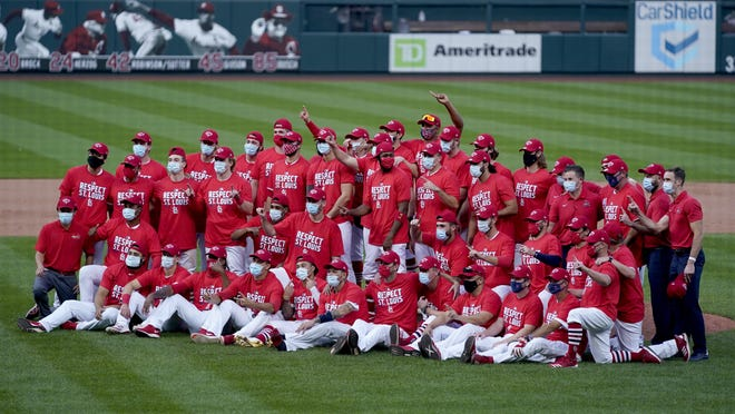 Members of the St. Louis Cardinals celebrate after defeating the Milwaukee Brewers on Sunday to earn a playoff berth. St. Louis travels to San Diego to play the Padres in a wild-card series starting Wednesday.