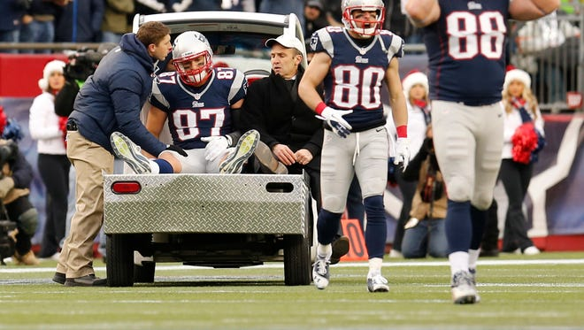 New England Patriots tight end Rob Gronkowski (87) is taken off the field in the second half of a game against the Cleveland Browns at Gillette Stadium.