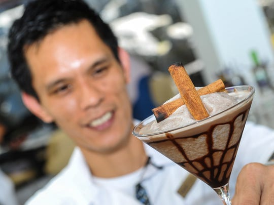 Bartender Jun Navarro serves up a chocolatey-blended Haller's Web cocktail to cool the tropical outdoors of the Tasi Grill.