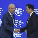 President and Founder of the World Economic Forum, Klaus Schwab, left, welcomes Chinese Vice President Li Yuanchao on stage for a special session at the WEF's annual meeting in Davos, Switzerland, on Jan. 21.