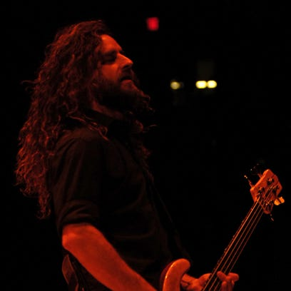 Justin Chancellor plays bass with Tool during the band's