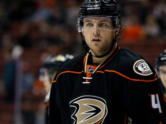 This Dec. 11, 2016 photo shows Anaheim Ducks defenseman Cam Fowler (4) looking over during a time out in action during the first period of an NHL hockey game against the Ottawa Senators in Anaheim, Calif. Fowler has returned to practice with the Ducks nearly three weeks after a knee injury, and the All-Star defenseman could be on target to return to their lineup for their second-round playoff opener against Edmonton. (AP Photo/Alex Gallardo)