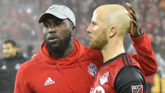Jozy Altidore (left) will miss the first leg of the Eastern Conference final against the Columbus Crew.