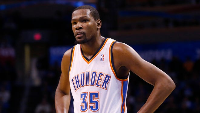 Oklahoma City Thunder forward Kevin Durant (35) waits to take a foul shot in the fourth quarter of an NBA basketball game against the Portland Trail Blazers in Oklahoma City, Tuesday, Jan. 21, 2014. Oklahoma City won 105-97.