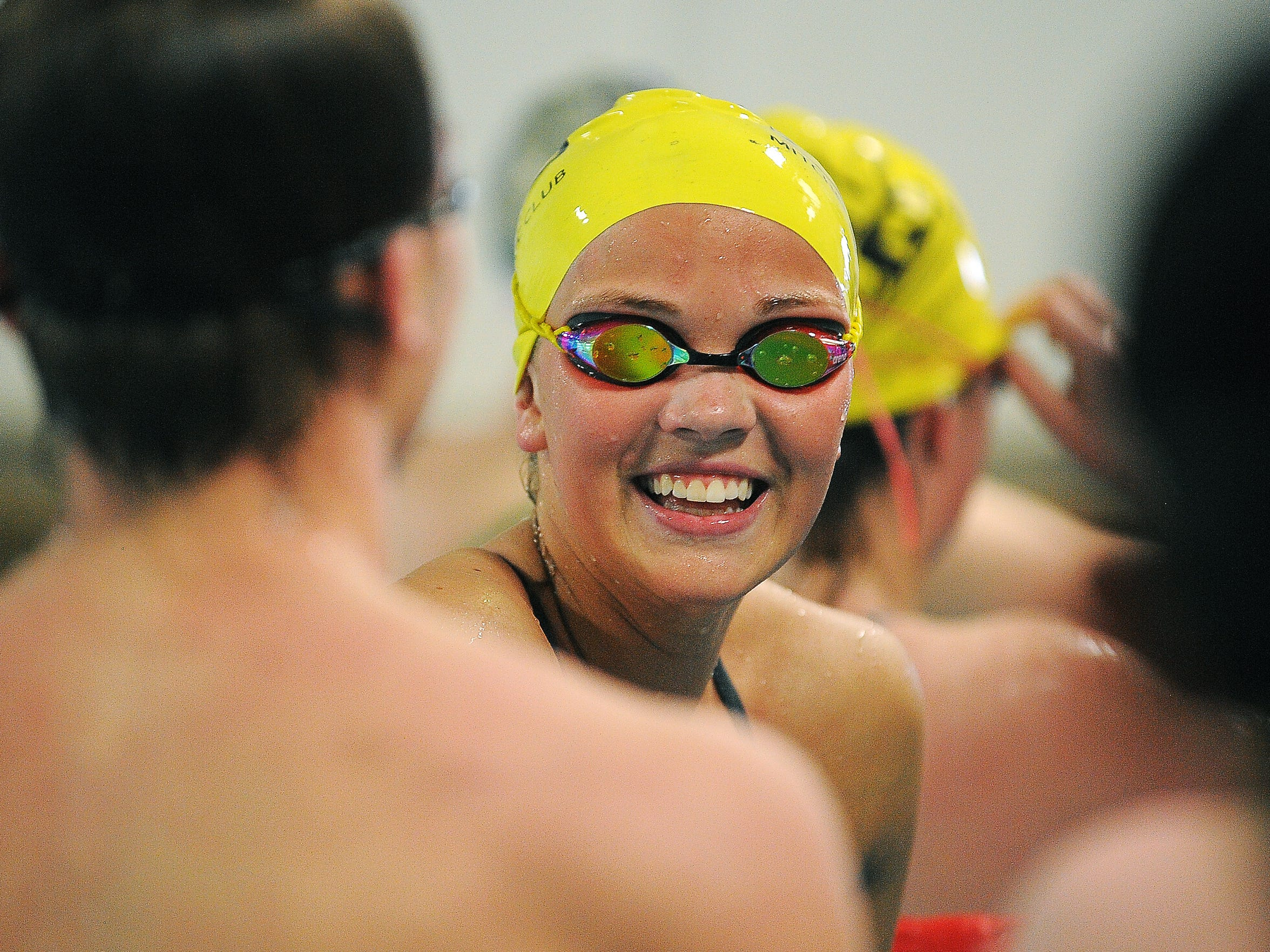 Tevyn Waddell, 16, cracks a smile while talking to teammates during a Mitchell Aquatic Club practice on Thursday, April 23, 2015, at the Mitchell Aquatic Club in Mitchell, S.D.