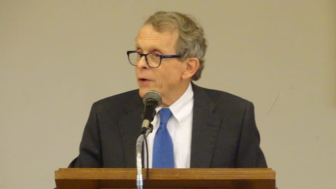 Ohio Attorney General Mike DeWine discusses the problems facing the state's next governor Wednesday during a presentation in Bucyrus.