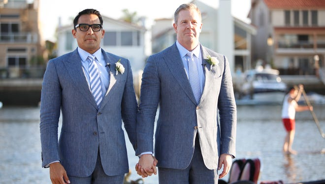 Oscar De Las Salas (left) and Gary Jackson pose for a photo during their wedding, Saturday, Oct. 11, 2014, in Coronado, Calif. Their first wedding was interrupted by a heckler yelling homophobic slurs.