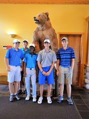 Junior golfers (left to right) Michael Maser (South