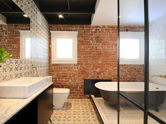 The bathroom of this remodeled bungalow features original