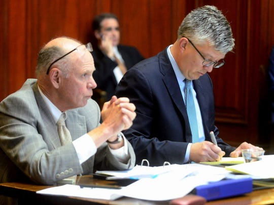 Attorneys Robert Hemley, left, and Brady Toensing listen to the Vermont Attorney General's Office case during oral argument at the Vermont Supreme Court on June 7.