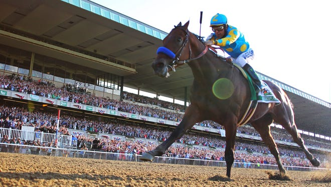 Victor Espinoza aboard American Pharoah (5) goes on to win the 2015 Belmont Stakes and the Triple Crown at Belmont Park.