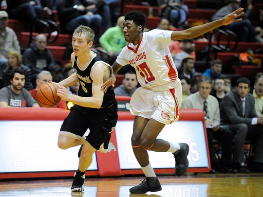Boonville's Glen Rouch (5) drives past Bosse's Romeo Parker (30) during their game at Bosse High School in Evansville, Friday, Jan. 20, 2017.