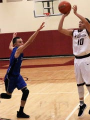 Tularosa's Josh Chavez, right, attempts a three-pointer. Chavez tallied a game-high 19 points.