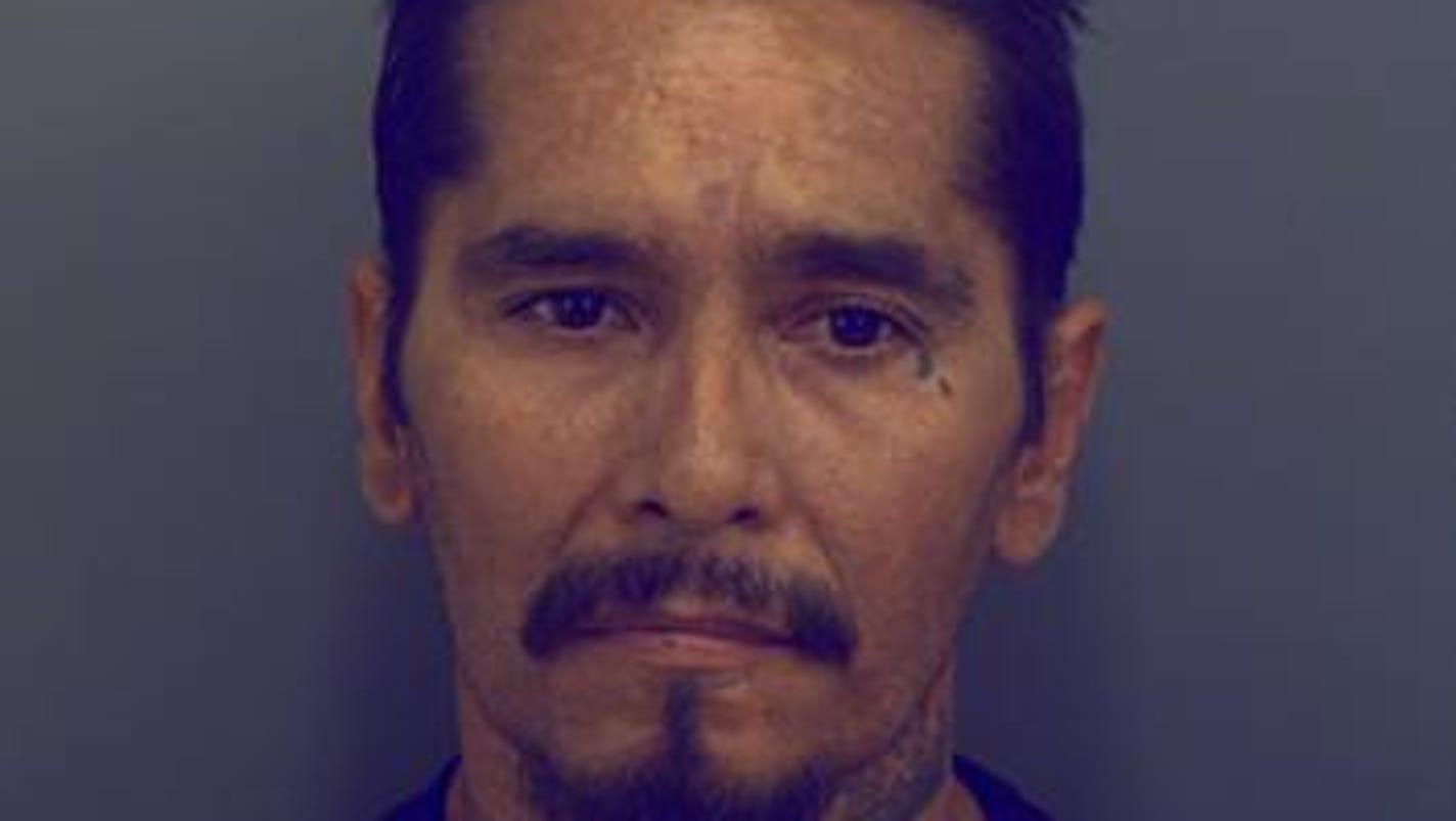 Gang member gets 9 years in racketeering case