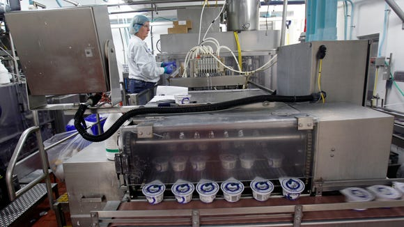A worker monitors production of Chobani Greek Yogurt in South Edmeston. The plant is one of the motivating factors behind yogurt being named New York's official snack.