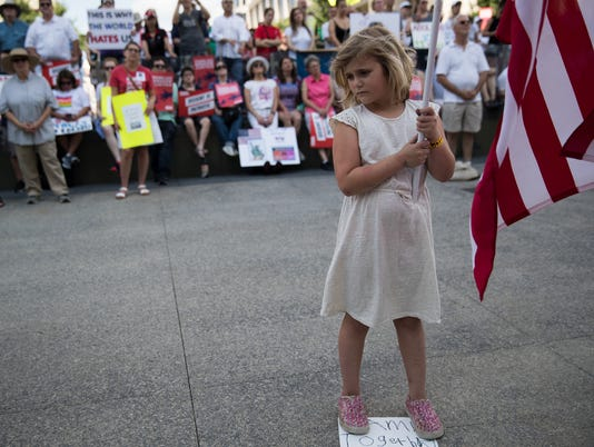 Josephine Shaver holds a U.S. flag